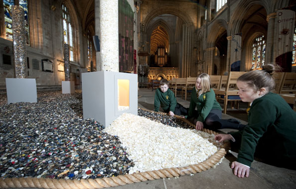 Photo copyright: Richard Hanson (0793 908 1208)Pupils from Ripon Cathedral CE Primary School, visiting 'Six million +', an art installation to commemorate the Holocaust, in Ripon Cathedral.  The pupils had helped collect some of the over six million buttons that make up the installation, which was produced by artist Antonia Stowe.l to r: Owen Foster, Joanna Magrs, Katie Chandler (all year 6).Commissioned by Keval at TES design desk.20.01.10Press release follows:6 million +, Every person counts, is a artwork of 6 million buttons, each one representing someone killed in the Holocaust and it will be mounted at the Cathedral from January 13th until February 20th. The Õ+Ô refers to Jewish and non-Jewish individuals who were not counted and the millions who have died across the world in genocides since the Second World War, and children from local schools have been collecting buttons to add to the exhibition.The installation was originally designed by Leeds based artist Antonia Stowe who was commissioned to work with the Kirklees Museums & Galleries.